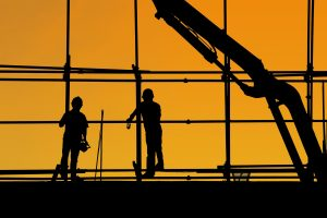 Blog post image of construction workers at sunset representing sustainable future
