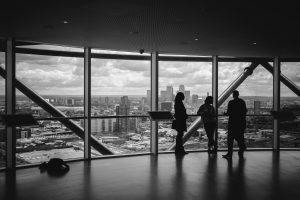 People talking overlooking Canary Wharf skyline