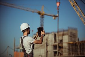 Construction worker using construction technology on a tablet